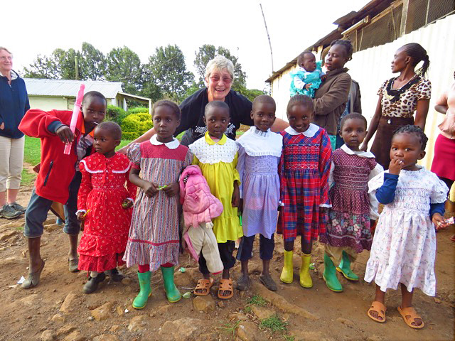 A woman traveller embraces african kids